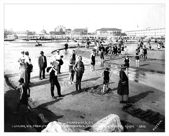 1922 - Beach patrons with new boardwalk under construction in the background Old Vintage Photos and Images