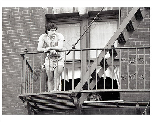 Guy on balcony Manhattan 1970