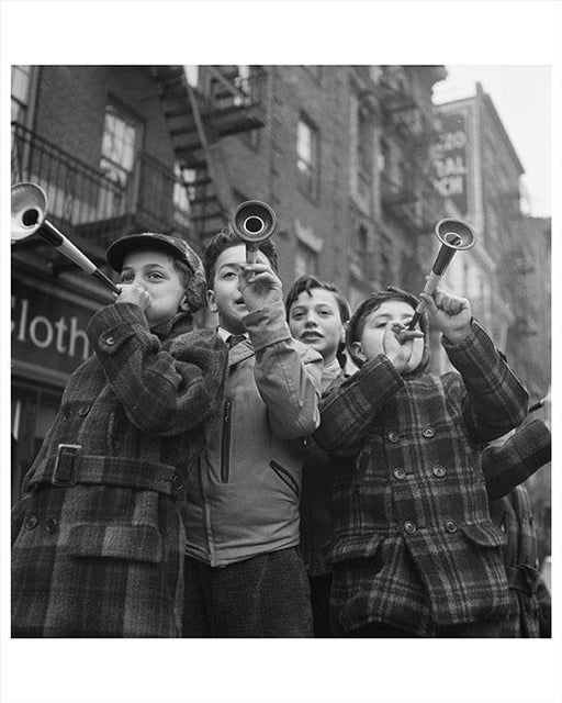 Photo of NYC Kids Blowing Horns On New Years Day