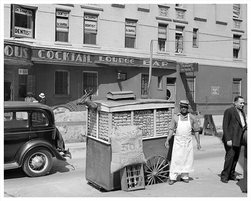 Peanut wagon on Lenox Avenue & 133rd Street NYC 1938