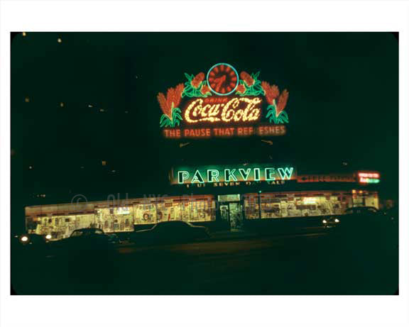 A classic Coca Cola Neon Sign Lighting up Manhattan 1955 NYC Old Vintage Photos and Images