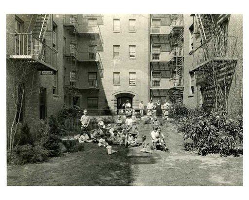 A family in their courtyard - Jackson Heights - Queens NY Old Vintage Photos and Images