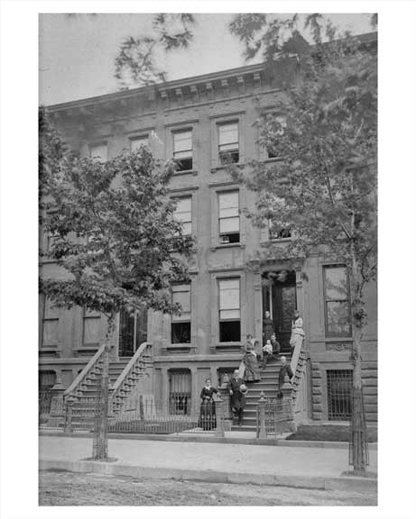 A family poses outside their building in Fort Greene Brooklyn Old Vintage Photos and Images