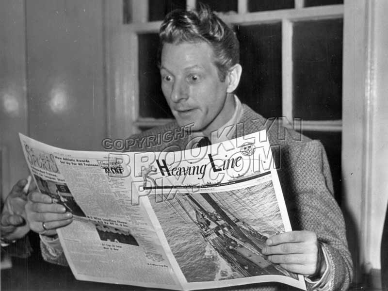 Actor Danny Kaye reading copy of The Heaving Line, during WWII Old Vintage Photos and Images