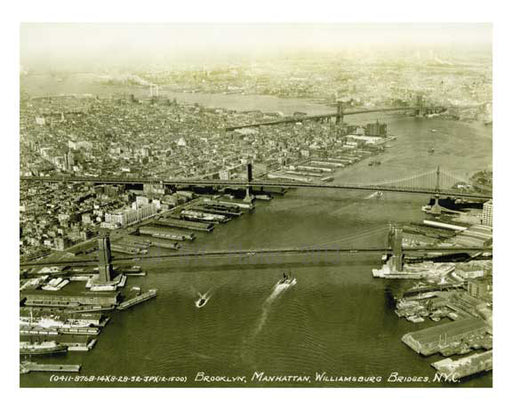 Aerial Shot of NYC Including Manhattan Isle,  Manhattan, Williamsburg, Brooklyn Bridges - New York, NY Old Vintage Photos and Images