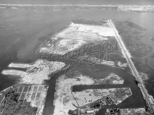 Aerial view of Barren Island, Bergen Beach, and Mill Basin, Rockaway Peninsula in distance; Flatbush Avenue on right, 1928 Old Vintage Photos and Images