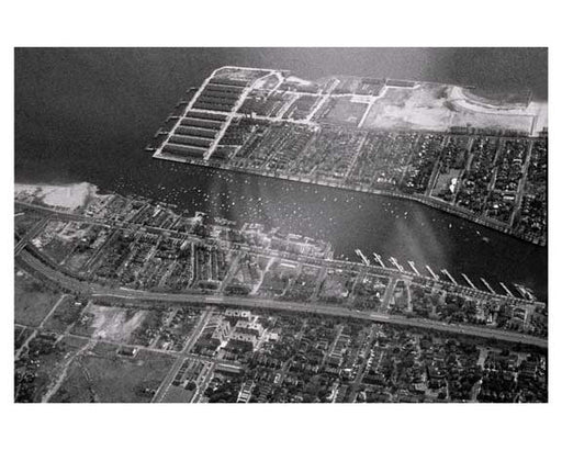 Aerial view of Sheepshead Bay 1940s with the Belt Pkwy running along side it- Brooklyn, NY Old Vintage Photos and Images