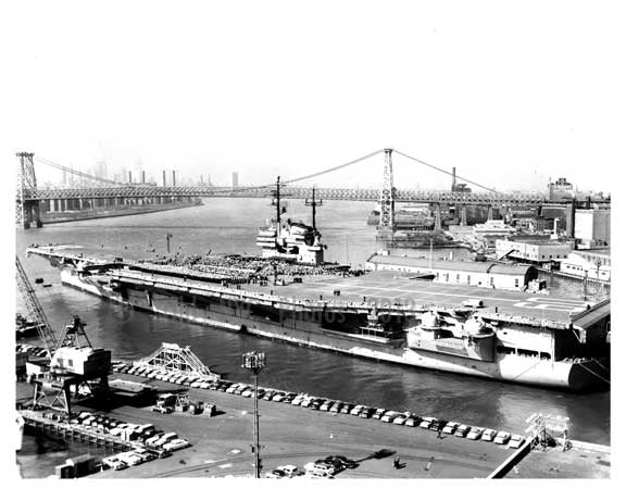 An aerial view of ships docked at the Navy Yard with the Williamsburg Bridge in the Background -  Brooklyn NY Old Vintage Photos and Images