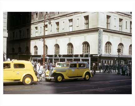Yellow Taxis passing in front of Astor Bar Old Vintage Photos and Images