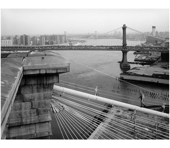 Brooklyn Bridge - View from the top of Brookltn Tower - showing man walkingup the main cable & the Manhattan bridge behind - 1982 Old Vintage Photos and Images