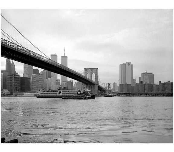 Brooklyn Bridge - view lookiong west from Brooklyn shore with ferry boat in the river 1982 Old Vintage Photos and Images