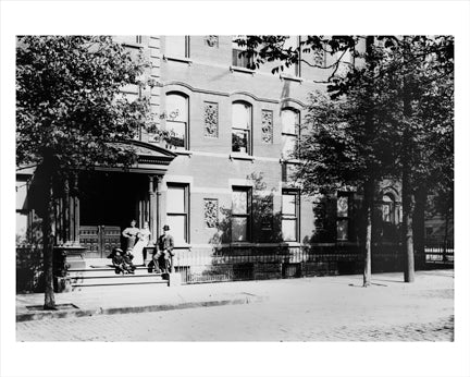 Family on Bed-Stuy Building Steps