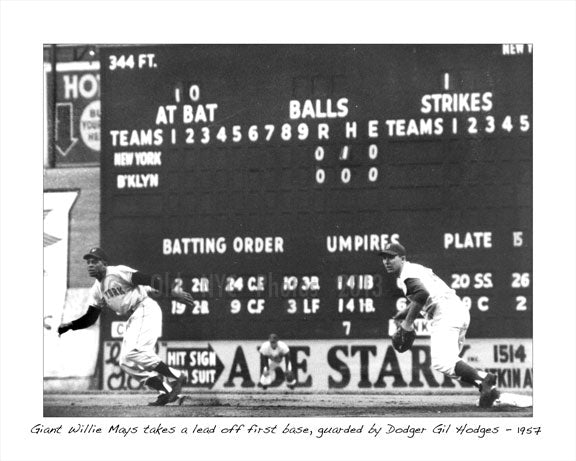 Giant Wille Mays takes a lead off first base, guarded by Dodger Gil Hodges 1957