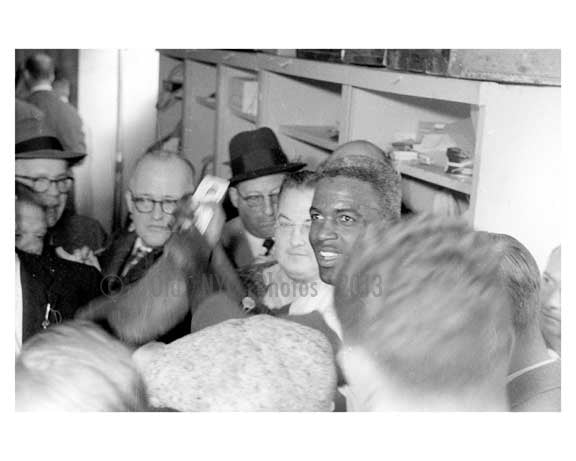 Jackie Robinson in the Dodgers locker room with the Press after the game 1