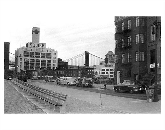 Manhattan Bridge behind buildings as seen from DUMBO Brooklyn NY Old Vintage Photos and Images