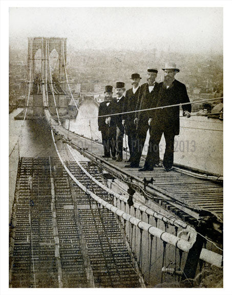 Men standing on Brooklyn Bridge under construction Old Vintage Photos and Images