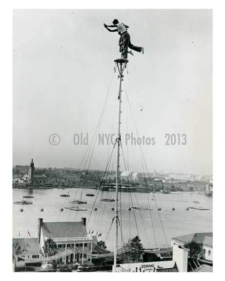Performers atop a 140 foot pole in the amusement area at the World Fair 1939 Flushing  - Queens NYC Old Vintage Photos and Images