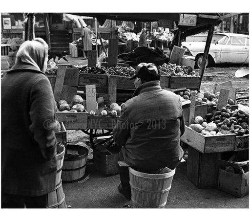 Produce vendor - bundled up against the cold, sits on a bushel basket by his pushcart. Old Vintage Photos and Images