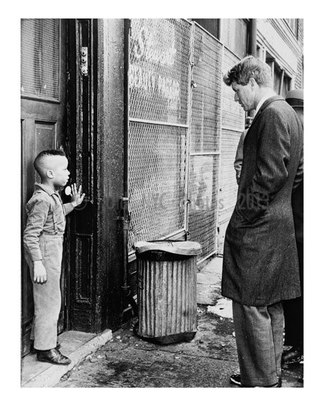 Senator Kennedy discusses school with young Ricky Taggart of 733 Gates Avenue Old Vintage Photos and Images