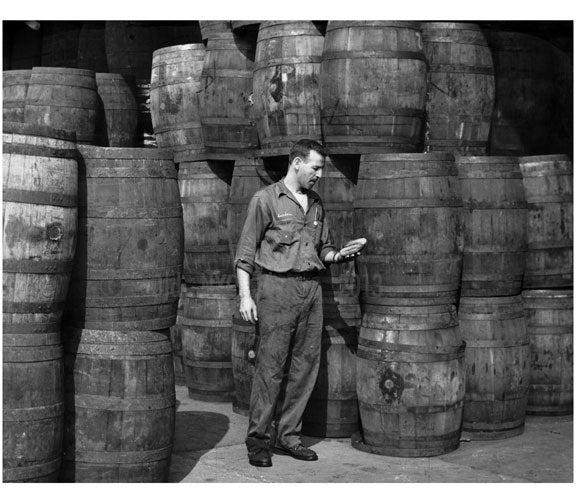 Stanley Hyams, co owner of Washington Pickle Works, in a room full of barels of pickles 1959 Old Vintage Photos and Images