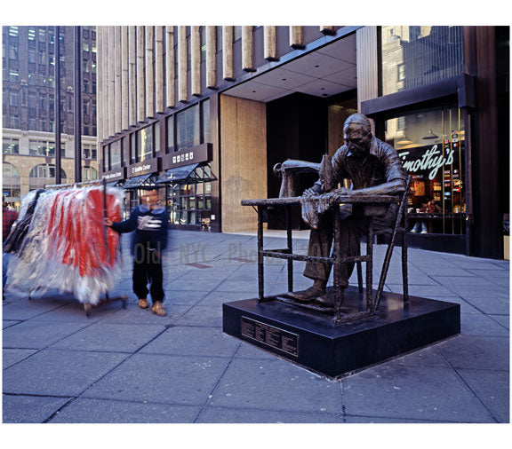 Statue of a garment worker on 7th Avenue in Manhattan in the heart of New York City's Garment District Old Vintage Photos and Images