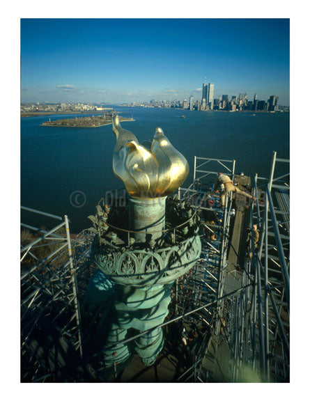 Statue of Liberty - new Torch & Flame with Manhattan Skyline in background - workers begin to dismantle the scaffolding Old Vintage Photos and Images