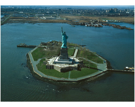 Statue of Liberty - overall view of Liberty Island looking Northwest with Jersey City in the background Old Vintage Photos and Images