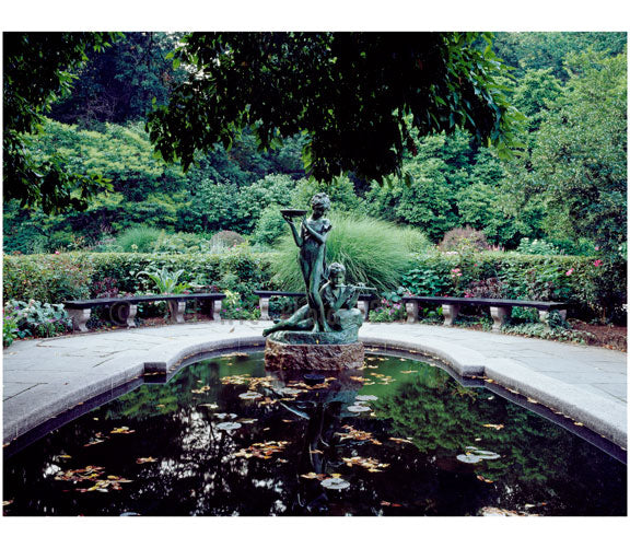 "Statue of Mary & Dickon from Frances Hodgson Burnett's ""The Secret Garden"" at the reflecting pool of the conservatory Garden in Central Park Old Vintage Photos and Images"