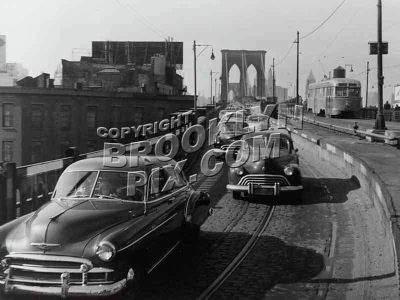 Trolley descending Brooklyn Bridge into Brooklyn on former el tracks near end of operation, 1950 Old Vintage Photos and Images