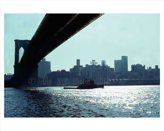 Tug boat passing infront of the Brooklyn Bridge 1960 NYC Old Vintage Photos and Images
