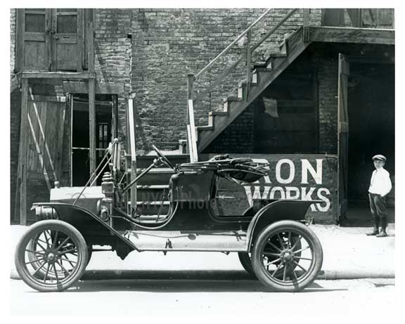 Upclose shot of a (now) classic Ford outside of Iron Works on 7th Avenue  - Midtown Manhattan - 1914 Old Vintage Photos and Images