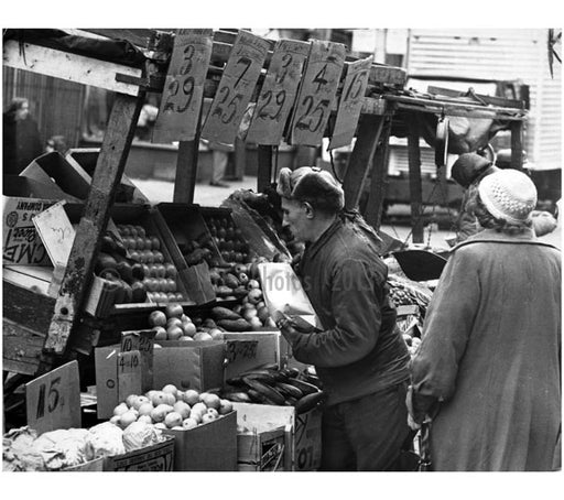 Vendor selling produce from his pushcart at the Belmont Avenue market Old Vintage Photos and Images