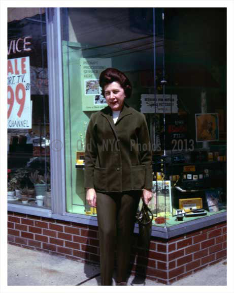Woman posing outside a Kodak Photo Store in the 1966 Old Vintage Photos and Images