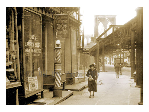 woman walking past shop with the Brooklyn Bridge in the background Old Vintage Photos and Images