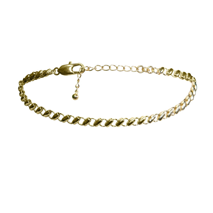 Fine gold beaded choker for an everyday look. We love to layer this piece for a bold touch. Wear it on it's own for a fine touch to your look.