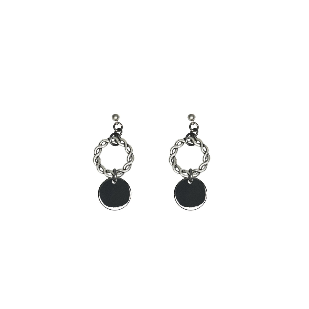 It's all in the detail. Our dangling circle earrings in oxidized silver has all the detail you in in one mini earring. The hoop is engraved with a detailed design that makes it one of a kind.