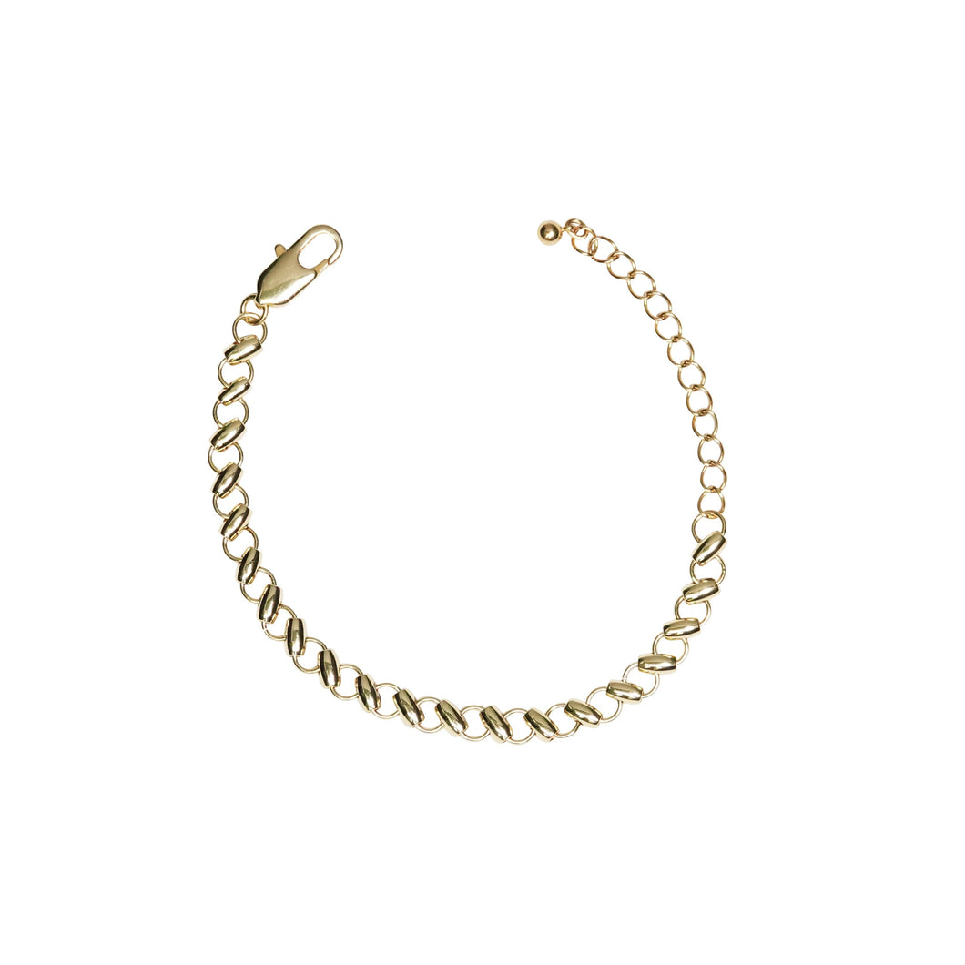 From JoRocco's fine collection, our Bonnie bracelet in gold is handmade with adjustable links so that she fits your wrist perfectly. Best paired with it's matching Avi choker.