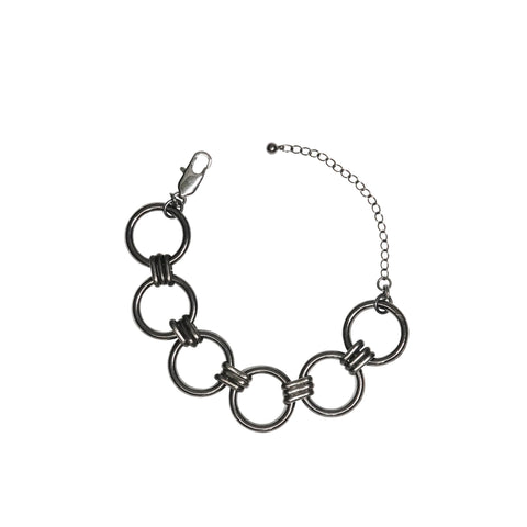 Our signature circle bracelet in gunmetal is meant to be worn with every look. Dress it up or dress it down. Either way it will be uniquely yours