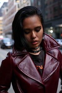 Leather bracelets that can be worn as chokers.
