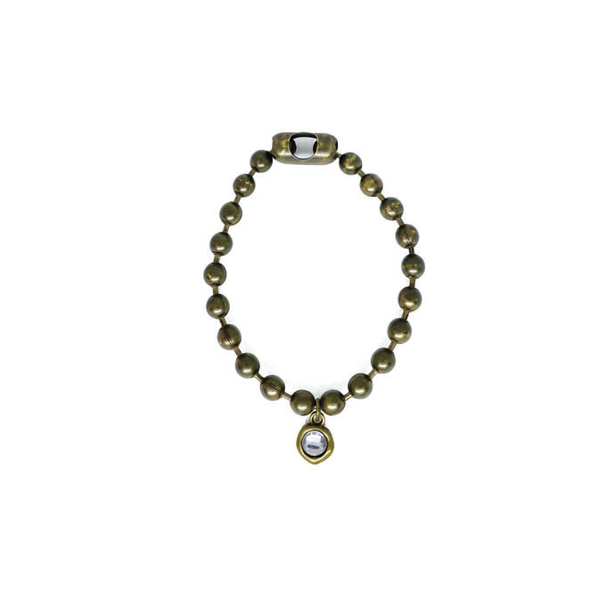 Gold ball chain bracelet with crystal charm.