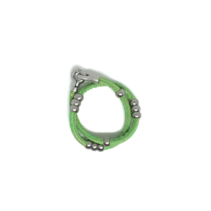 Green leather wrap bracelet and choker with silver detail.