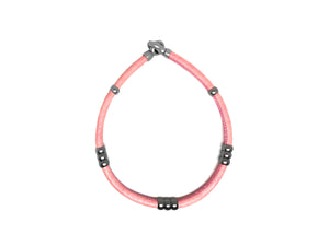 Custom pink leather bracelet and choker jewelry.