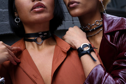 Up close and person with our black leather Ajax choker. This necklace is bold enough to wear on it's own, but why not add our Beck bracelet turned choker to the mix?