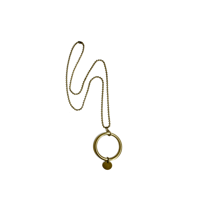Gold chain necklace with large circle.