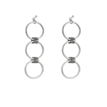 Statement earrings aren't for the shy of heart. Our silver dangling hoop earrings are a conversation worth having.