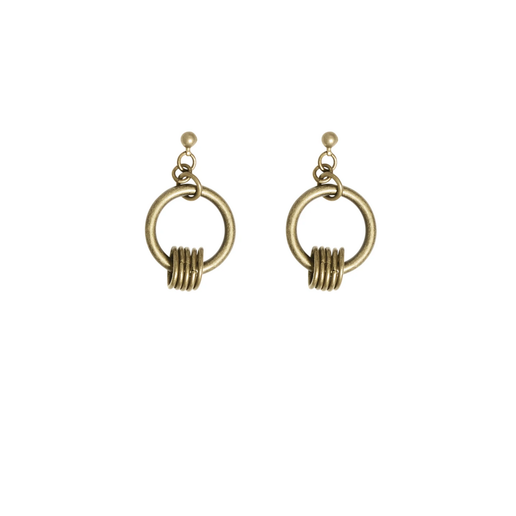 Women's gold dangling earrings.