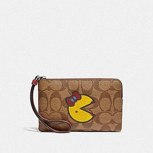 COACHCORNER ZIP WRISTLET IN SIGNATURE CANVAS WITH MS PAC-MAN F75594 (KHAKI MULTI/SILVER)