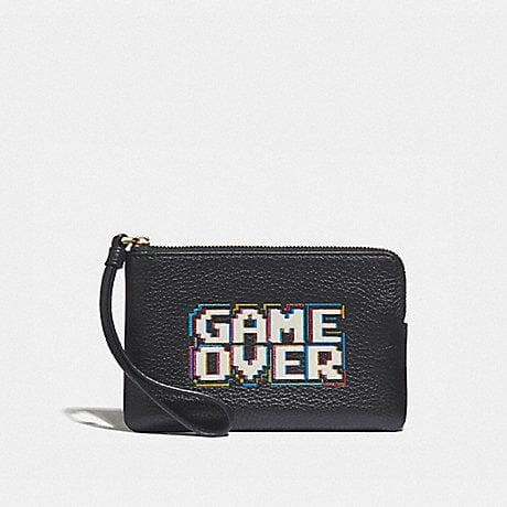 COACH CORNER ZIP WRISTLET WITH PAC-MAN GAME OVER F73399 (BLACK/MULTI/GOLD)