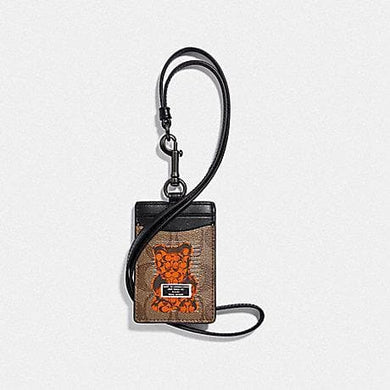 COACH ID LANYARD IN SIGNATURE CANVAS WITH VANDAL GUMMY F77927 (TAN/BLACK ANTIQUE NICKEL)