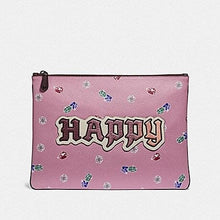 Load image into Gallery viewer, DISNEY X COACH LARGE WRISTLET 30 WITH HAPPY F72913 (MULTI)